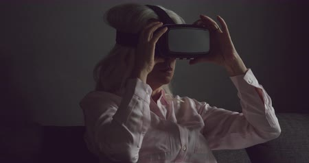 retiro espiritual : Side view close up of a senior Caucasian woman wearing a VR headset