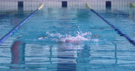 goggles : Front view of a young Caucasian female swimmer training in a swimming pool, breaststroke Stock Footage