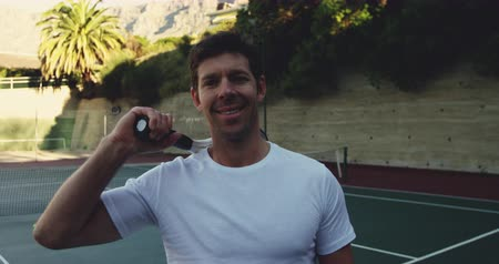 tennis whites : Portrait of a young Caucasian male tennis player, wall in a background
