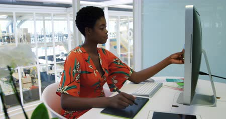 color swatch : Side view of a young African American female business creative working in a modern office, using a graphics tablet and colour wheel Stock Footage