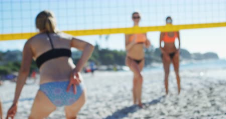 volleyball players : Female volleyball player gesturing while playing volleyball at beach 4k