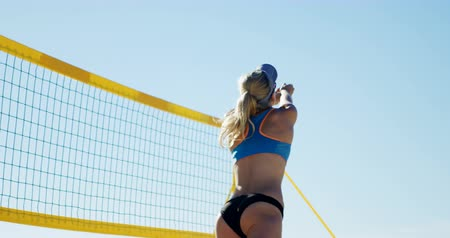 beach volleyball : Female volleyball players playing volleyball in the beach 4k Stock Footage