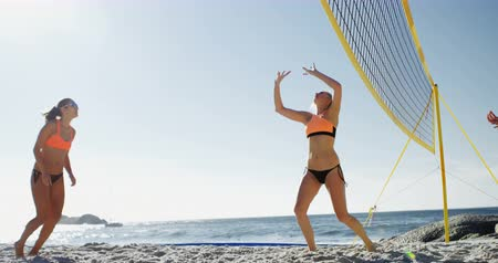 atlet : Female volleyball players playing volleyball in the beach 4k Stok Video