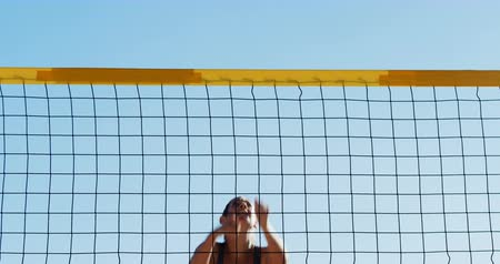 beach volleyball : Female volleyball player playing volleyball in the beach 4k Stock Footage