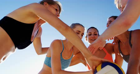 volleyball players : Female volleyball players forming hand stack in the beach 4k