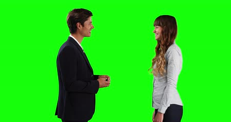firma : Side view of a Caucasian male sales advisor giving car keys to a Caucasian female lessor, smiling and shaking hands, on green screen background. Wideo