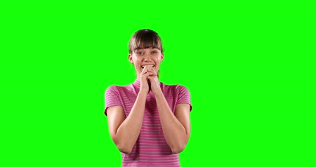mutlu : Portrait of a happy Caucasian woman with long dark hair, wearing a striped t-shirt, smiling and looking straight into a camera on green screen background.
