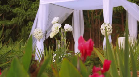 embellished : Jewish traditions wedding ceremony. Wedding canopy chuppah or huppah. A Jewish wedding takes place under a huppah, which symbolizes the new Jewish home being created by the marriage. Stock Footage
