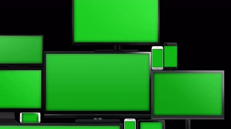 múltiplas : Many different types of screens. TVs, computer monitors, smartphones and tablets. They laid on each other in a pile isolated on a white background. They are all with a green screen. With alpha. Vídeos