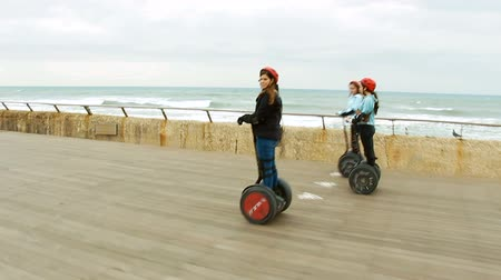 personal transporter : Tel Aviv, Israel - December 29, 2013: Group of people traveling on Segway.
