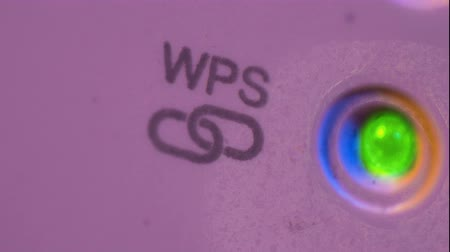 macro fotografia : Cinemagraph of WSP symbol blinking signal connection status led light in WiFi repeater. Macro closeup The device is in electrical socket on the wall. It help to extend wireless network in home or office.