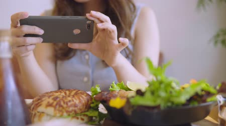 grelhado : Closeup Hand Holding Phone Shooting Food Photograph