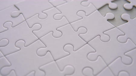 perdão : Completing The White Puzzle Stock Footage