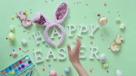 candy : Colorful easter egg decoration on green background. Stock Footage