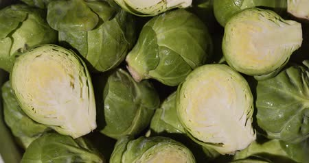 brusel : Rotation Shot Of Close Up Fresh Green Brussel Sprouts In The Basket