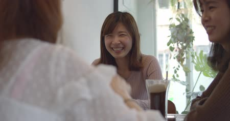 cheers : Asian Woman Chatting In Restaurant