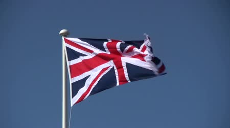 zvedák : The British Union Jack flag blowing in the wind.