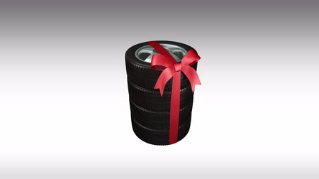 pneus : the wheels with new tires are stacked and packaged as a gift, alpha matte