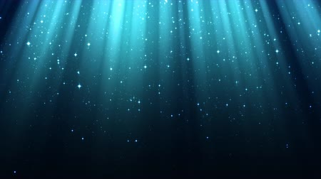 Blue background with rays of light, divine radiance, sparkles, night shining starry sky, seamless loop