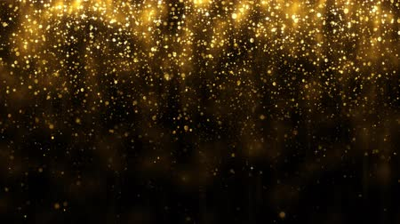 Background with falling golden glitter particles. Falling gold confetti with magic light. Beautiful light background. Seamless loop