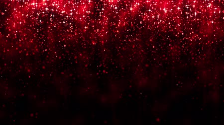 Red background with falling glitter particles. Beautiful festive sparkling background. Falling shiny particle bokeh with magic light. Valentines day. Seamless loop Stock mozgókép