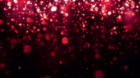 Red bokeh background with falling glitter particles. Beautiful festive sparkling background. Falling shiny particle with magic light. Valentines day. Seamless loop