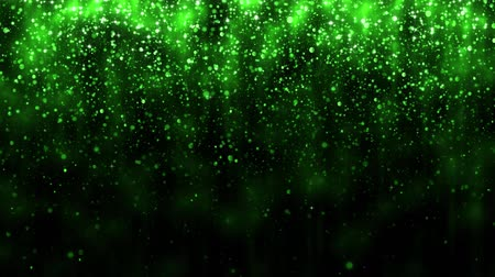 Beautiful glitter light background. Background with green falling particles. Holiday design. Falling bright particle and magic light. Seamless loop