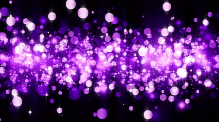 Background with shiny magenta particles. Beautiful bokeh light background. Magenta confetti shimmering with magical sparkling light. Seamless loop Stock mozgókép