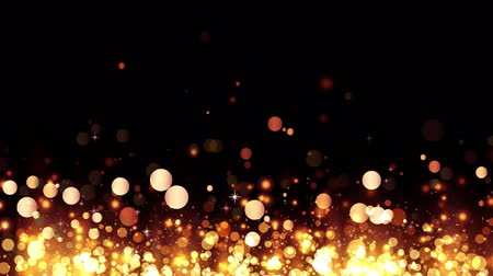 stardust : Background with shiny golden particles. Glittering rising gold particles. Beautiful bokeh light background. Golden confetti with magical shimmering sparkling light. Seamless loop