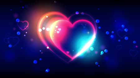 si přeje : Valentines day animation background. Happy valentines day animated greeting cards. Bright multi-colored heart shape on dark bokeh background. Blue and golden shine. 4k video Dostupné videozáznamy