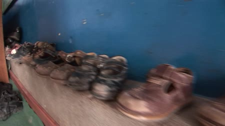 neediness : Shoes of a child in Peru Stock Footage