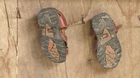 indigence : Shoes of a child in Peru Stock Footage