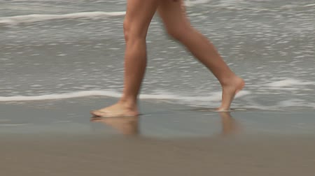atletismo : Video footage of a Woman at beach Stock Footage