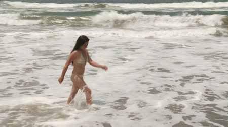 jogging : Video footage of a jogging Woman at beach Stock Footage