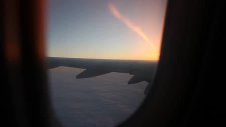 брезент : video footage of a flying airplane over the clouds in the evening