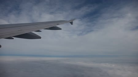 брезент : video footage of a flying airplane over the clouds timelapse