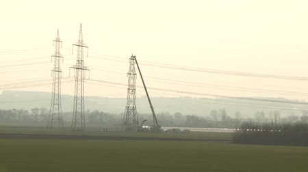 nukleární : video footage of people working on a power pole in Germany