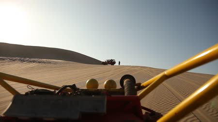 motorcar : video footage of a buggy trip in the sand desert in peru, south america