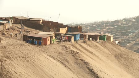cheerless : video footage of slums in the desert at the north of Lima, Peru, South America