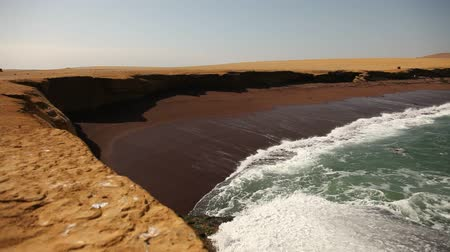 nemzeti : video footage of the so called Red Beach in the paracas national parc in peru, south america with the pacific ocean