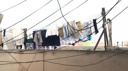 szárítókötél : video footage of drying clothes at a rooftop, Lima, peru, South America