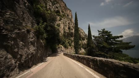 point of view pov : POV video footage of motorbikes on the mountain road SP 38 at the lake garda in italy, europa