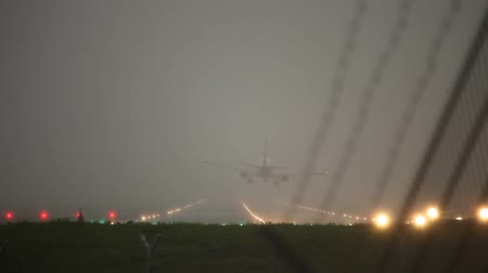 брезент : video footage of a stormy landing airplane at Hamburg Airport