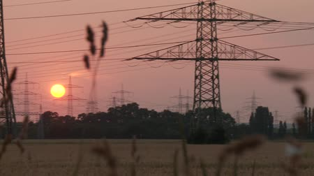 authorities : video footage of a landscpape with electrical towers