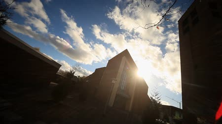 clergy : video footage of a church with sun and clouds