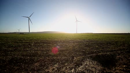 authorities : video footage of a wind turbine in front of the sun, germany Stock Footage