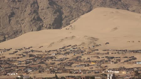 neediness : Video footage of huts or Slums in the desert near Trujillo, Peru