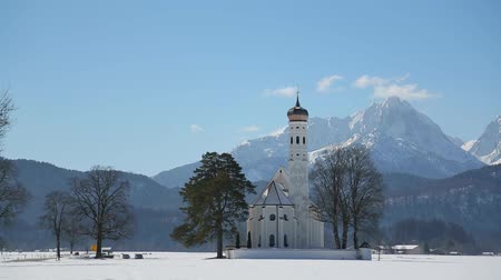 bajor : video footage of the Church of St. Coloman in sunny winter landscape, Schwangau, Germany