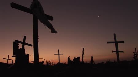 churchyard : video footage of a cemetery in Peru in the sunset with silhouettes of cruces Stock Footage