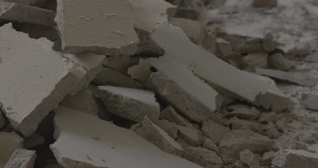 destruct : Video footage of a destroyed floor tile in a house